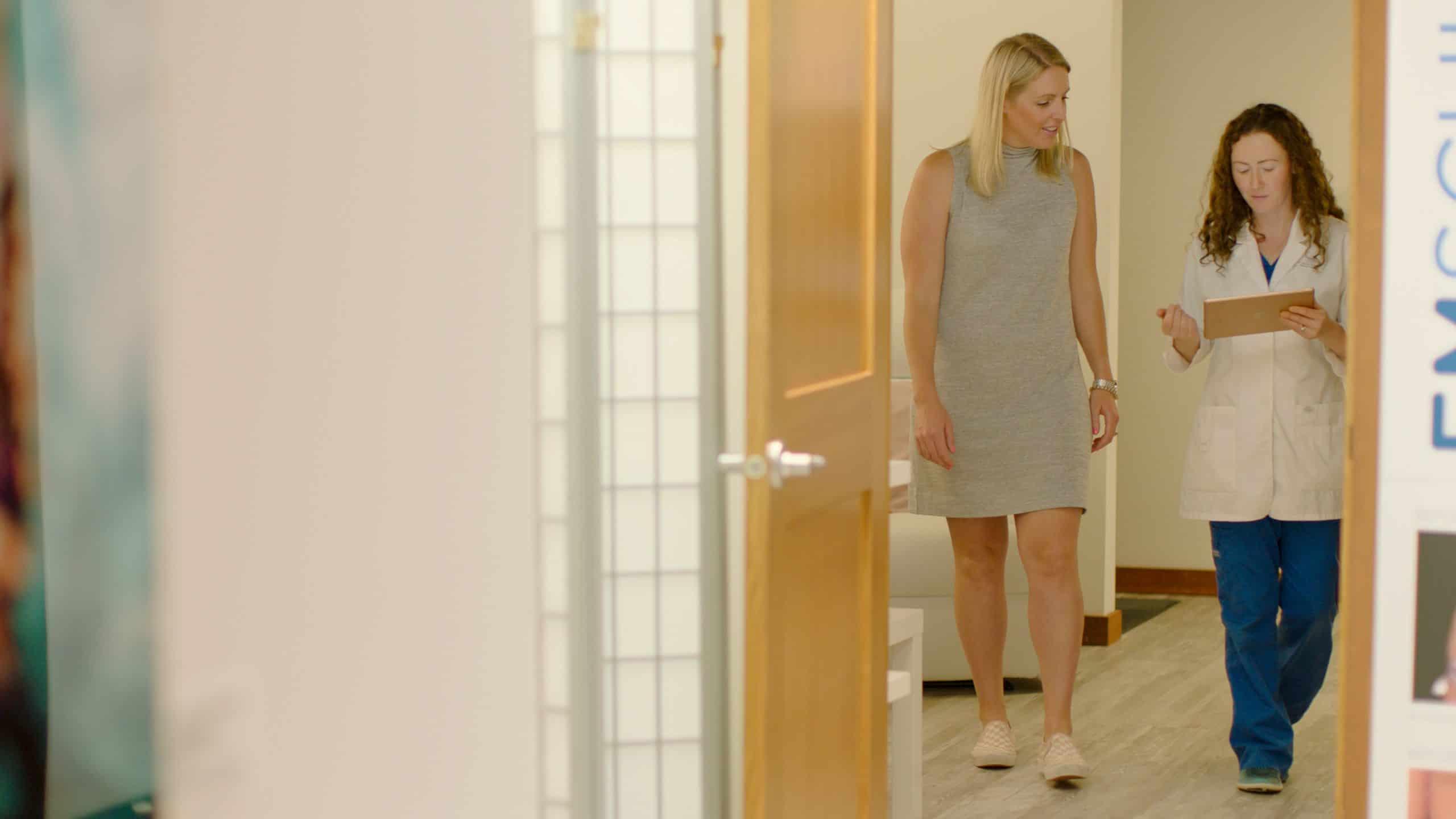 Sarah walking with patient